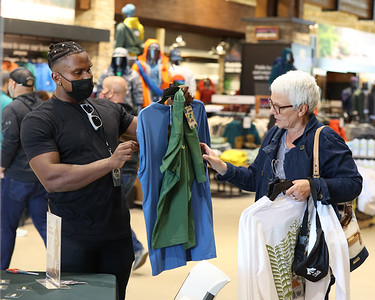 Public Lands associate Cyruss Powell Jr. helps Debbie Sigmund whith her purchases at the Public Lands grand opening in Cranberry Friday. The new outdoor store owned by Dicks Sporting goods is geared towards outdoor recreation. The Cranberry location is one of two trial stores. Seb Foltz/Butler Eagle 09/24/21