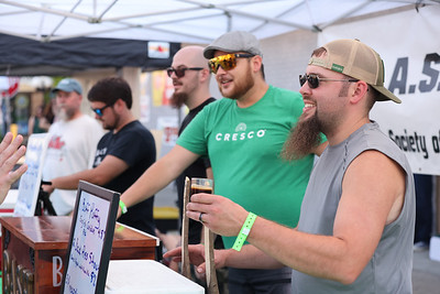 Gerry Sapp serves a beer sample at the Butler Area Society of Homebrewers tent at Mars Brew Fest Saturday. Seb Foltz/Butler Eagle 09/18/21