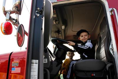 Abel Adam, 5, and Isla Adam, 2, explore a salt truck at the Mars Agway Touch a Truck on Saturday. Julia Maruca/Butler Eagle