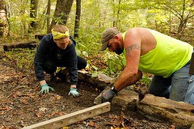 Volunteers Bill Updegrove and Shandi Stewart help measure a path during the National Public Lands Day volunteer cleanup at Jennings Environmental Education Center on Saturday. Julia Maruca/Butler Eagle