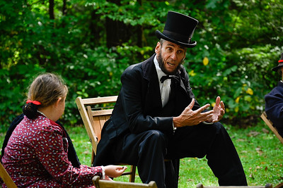 Saturday afternoon at the Heritage Festival. Rick Miller, portraying President Abraham Lincoln, talking to a young girl.. The 29th annual McConnells Mill Heritage Festival will take place from 10 a.m. to 6 p.m. Sept. 25 and 11 a.m. to 5 p.m. Sept. 26 at the Kildoo Picnic Area & Gristmill at McConnells Mill.  The event, which is sponsored by the Rotary Club of Portersville-Prospect, celebrates the time period of 1852-1928, when the gristmill harnessed the power of the Slippery Rock Creek to grind wheat for bread. Attendees can tour the mill and see its original machinery, visit a Civil War encampment, participate in art and craft demonstrations, partake in different family activities, and enjoy live music. Artists and craftspeople from the local area demonstrate their skills and have their wares for sale. Elizabeth (Liz) Linton/special to the Eagle