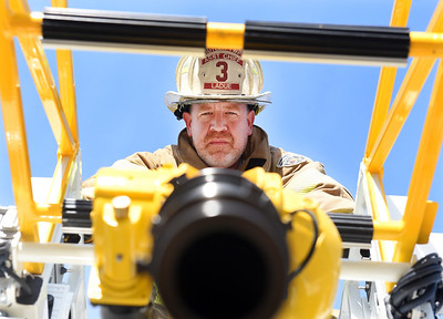 Assistant Chief, Joe LaDue, stares down the barrel of the water canon mounted on the Butler Fire District #3 new ladder truck. Harold Aughton/Butler Eagle