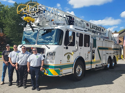 Butler Township Volunteer Fire District had a new ladder truck custom-made to fit the needs of the station. From left are Dalton Keibler, Dexter Keibler, Kevin Smith and Joe LaDue. EDDIE TRIZZINO/BUTLER EAGLE