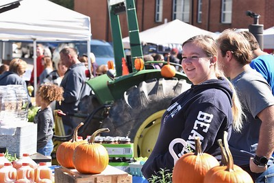 Sara Weigle greets customers at the the Zimmerman Family Farms stand at Mars' Applefest Saturday. Seb Foltz/Butler Eagle