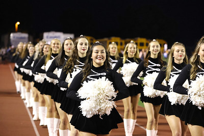 Brynne Barger (front left) and members of the Moniteau High School dance team march off  the field following their performance  at the Butler County Band Festival Wednesday. Seb Foltz/Butler Eagle 09/29/21
