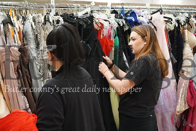 """Photo by J.W. Johnson Jr. Julia Hazel, a student at West Allegheny High School, looks through prom dresses Saturday at the Cranberry United Presbyterian Church's """"I Found the Gown"""" sale."""
