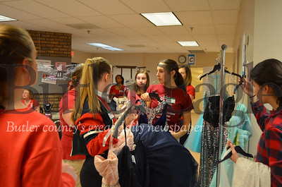 """Volunteer """"runners"""" grab rejected dresses to put back on racks for others to try on at the Cranberry Community United Presbyterian Church's annual """"I Found the Gown"""" sale on Saturday."""