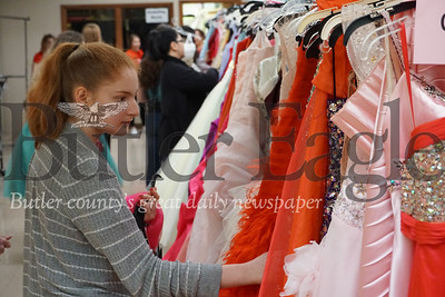 """Photo by J.W. Johnson Jr. Brianna Barnett, a student at Brookfield High School in Ohio, looks at dresses Saturday at the Cranberry United Presbyterian Church's """"I Found the Gown"""" sale."""