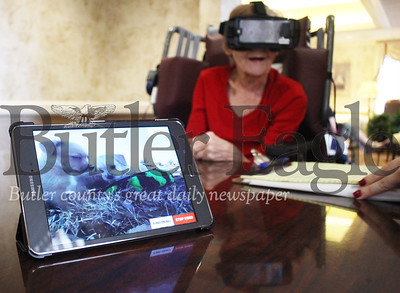 On Friday, St. Barnabas resident Joan Geibel watched a virtual reality program about dogs, playing a song in the background as a dozen blond puppies rush around the viewer in the headset.