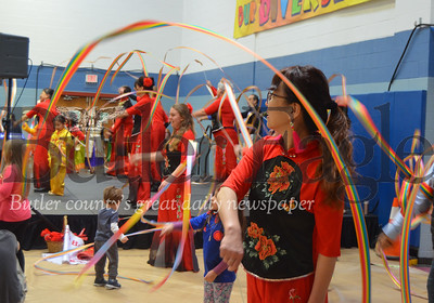Photo by Alexandria Mansfield. CUTLINE: The Pittsburgh Chinese Xiaobo Waist Drum Dance Group allows audience participation during the ribbon twirling portion of its performance Saturday in the gymnasium of the Cranberry Township Municipal Center.