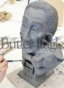 Harold Aughton/Butler Eagle: Butler High School Senior, Lisa Fields, puts the final touches on her sculpture of Salvador daliand his cat babbo for the FAB art showcase to be held 4:30 - 8:00 p.m., Sat., April 13 at the Butler Intermediate High School.
