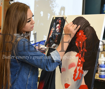 Harold Aughton/Butler Eagle: Katie Sequete, 18, a 12th grader at Butler High School, recreates a paiting of a japanese geisha girl for the FAB art showcase to be held 4:30 - 8:00 p.m., Sat. April 13 at the Butler Intermediate High School.