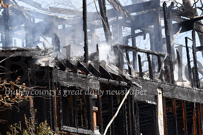 Harold Aughton/Butler Eagle: Firefighter from seven volunteer fire companies battled a house fire Tuesday morning in Mars Borough. The fire is under investigation.