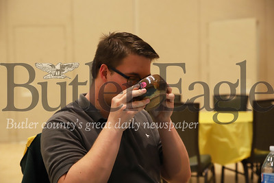 Brian Bernhardt, 23, sips soup out of his new bowl at Friday's Empty Bowls event.