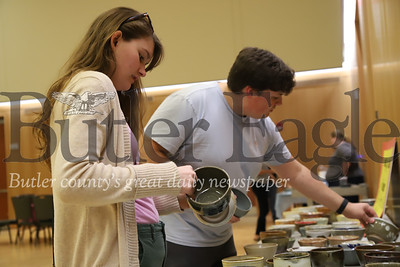 Slippery Rock junior Gabriella McAdams(left), 21, and Peter Shipe, 21, choose their favorite bowl at Friday's Empty Bowls event put on by the Student Government Association. The soup dinner is to promote food insecurities on college campuses.