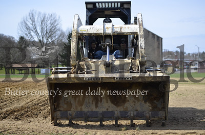 Don Clark of South Butler loosens up the softball field at Father Marinaro Park in preparation for flattening and resurfacing on Thursday. Tanner Cole/Butler Eagle
