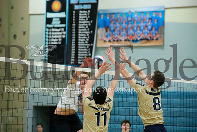 Seneca's Jacob Smeltzer goes for a spike on  Luke McEachin(11) and Nathaniel Sespico  (8) of Butler in Tuesday's win.