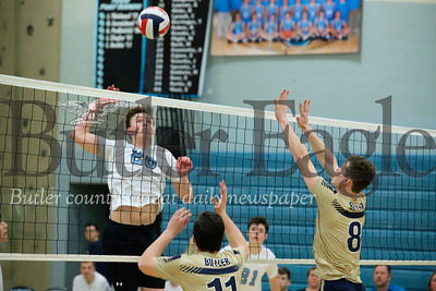Seneca's Jacob Smeltzer(28) goes for a spike on  Luke McEachin(11) and Nathaniel Sespico  (8) of Butler in Tuesday's win.