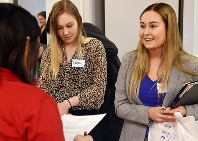 Harold Aughton/Butler Eagle: Alexis Zmijowski, a senior business major at Slippery Rock University speaks with recruiter Brianne Deal of Adeco a career fair held at the Butler Days Inn, Wednesday, April 17.