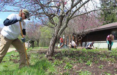 Harold Aughton/Butler Eagle: Michelle Bothun (on left) a labor for the PA. Department of Conservation and Natural Sources joined volunteers to pull weeds, rake leaves and put down mulch as part of an Earth Day spring clean up day at Moraine State Park.