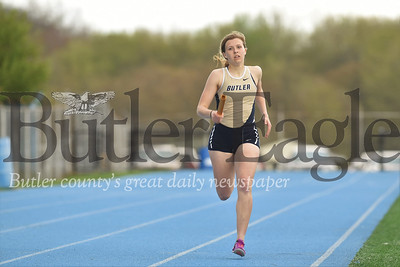 Butler's Anna Baxter holds a long lead on the final stretch of the girls 4x400 Tuesday against Seneca. Seb Foltz/Butler Eagle