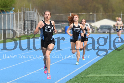 Seneca's Lizzie White leads teammates Megan Aaron and Bailey Royhab down the final stretch of the girls 1,600 meter Tuesday against Butler. The Seneca girls claimed the top three spots in the event. Seb Foltz/Butler Eagle
