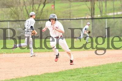 Slippery Rock's Alex Duffalo breaks toward third on his way to scoring in the Rocket's win over Oil City Wednesday. Seb Foltz/Butler Eagle