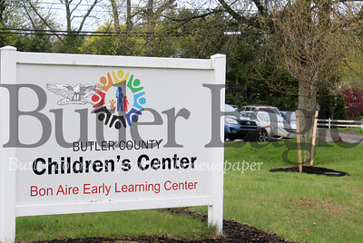 Harold Aughton/Butler Eagle: The Butler County Children's Center planted a new tree in honor of Jeffrey Warnick's contributions to The Boys Club.