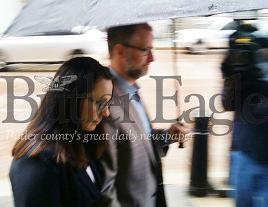 Stephanie and Scott Roskovski, who are facing federal charges that include allegedly embezzling $1.3 million from Butler Health System, walk into federal court Friday for their second court appearance. Photo by Eric Jankiewicz