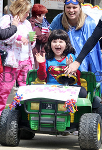 Harold Aughton/Butler Eagle: Macy Frame, 6, a student at EasterSeals in Cranberry Twp., and her classroom assistant Kelly Spiering, react to the crowd during the Superhero Parade held in honor of National Autism Awareness Month. Members of the VFW Post 879 colorguard led the parade along with police and ambulance personnel from Cranberry Twp.