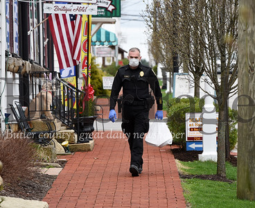 Harold Aughton/Butler Eagle: Saxonburg police chief Joe Beachem picksup a meal to be delivered Tuesday afternoon, March 31, 2020.