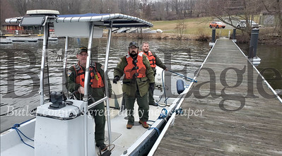 Moraine State Park ranger and supervisor Bryan Moore, assistant park manager Brian Flores, and park ranger Daniel Peterson board one a boat on Lake Arthur to do their job, which includes keeping visitors to the park safe. Photo by Nathan Bottiger/Butler Eagle