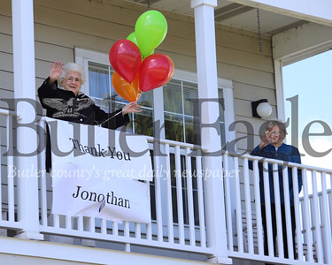 Residents at New Having Court at Clearview wave and offer their thanks to seven-year-old Jonathan French from a second floor balcony. French and his mom Breanne have been spray painting messages to area seniors on lockdown at their housing facilities. Seb Foltz/Butler Eagle
