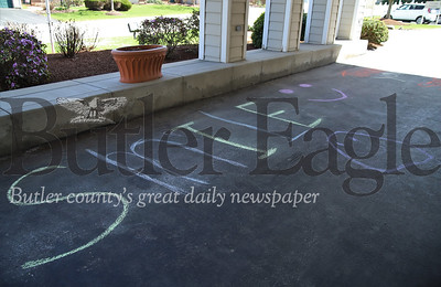 """Jonathan French, 7, and his mom Breanne French's chalk message to residents on lockdown at New Haven Court at Clearview senior center. The pair have also painted a message saying """"praying 4 your"""" on the front lawn. French and his mom have been spending the week writing messages to senior residents and first responders around the county this week. Seb Foltz/Butler Eagle"""