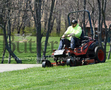 Harold Aughton/Butler Eagle: Joe Schriver of Adams Twp. Public Works department mows the fields in the community park Monday afternoon, April 6, 2020.
