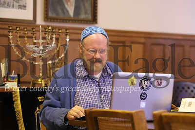 Congregation B'nai Abraham caretaker Ben Vincent leads his weekly bible study from his laptop while his class follows through a Zoom video conference. With the pandemic outbreak and the majority of his class members over 60, Vincent canceled the class early on in the outbreak but decided to resume through video chat. Seb Foltz/Butler Eagle