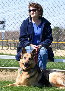 Harold Aughton/Butler Eagle: Karen Matsey of Mars, a retired elementary librarian, basks in the sun with her 5-year-old,  German shepard, Nika, Monday afternoon in Adams Twp. Community Park, April 6, 2020.