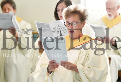 Harold Aughton/Butler Eagle: Mindy Benson of the Trinity Lutheran Choir performs one of the many songs during the pre-recorded Easter Sunday service, Wednesday, April 8, 2020.