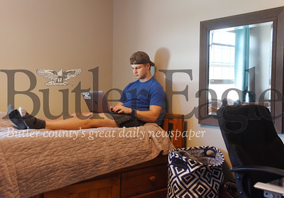 Harold Aughton/Butler Eagle: Jake Bunofsky, 19, a sophomore at John Carroll University, finds himself studying from his bedroom in Cranberry Twp. instead of a university dorm.
