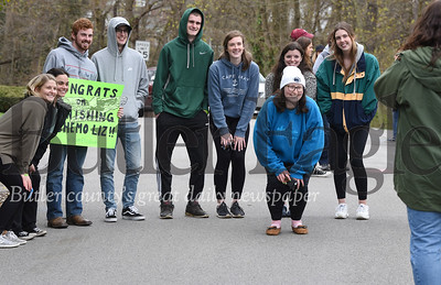 Harold Aughton/Butler Eagle: Elizabeth Barber poses for a photo with her friends as she returned home to a hero's welcome as nearly 100 friends, family and neighbors gathered along Haverford Drive in Butler to welcome Barber home from her last chemo session.