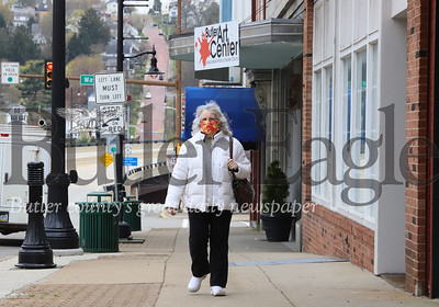 Deborah Haley of Butler walks down Main Street Thursday wearing a home made mask made by a friend. Haley said she's been wearing the mask any time she's outside in public. Seb Foltz/Butler Eagle