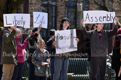 Harold Aughton/Butler Eagle: About 80 protesters and bystanders gathered at Diamond Park in Butler to protest Pennsylvania Governor Wolf's stay-at-home order.