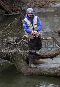 Harold Aughton/Butler Eagle: Tyler Schwer and his father, Jack, spent Tuesday fishing the Connoquennessing along Onieda Valley Road Tuesday morning.