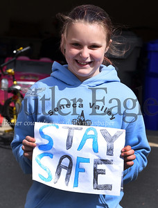 Harold Aughton/Butler Eagle: Malayna Smith, 9, a 4th grader at Rowan Elementary showed her support to her teachers as they drove past her Seven Fields home Monday morning, April 27, 2020.