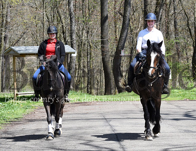 Harold Aughton/Butler Eagle: Riders from the Silvercrest boarding, from left, Erin Vensel on King Julian and Ava Noone on Bonjour Am Our take a ride through Glade Run Monday afternoon, April 27, 2020.