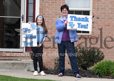 Harold Aughton/Butler Eagle: Emma Bergen, 8m and a 3rd grader at Rowan Elementary, joined her mother, Angela, showing their support to the teachers and first responders that drove passed their Cranberry Twp. home Monday morning, April 27, 2020.
