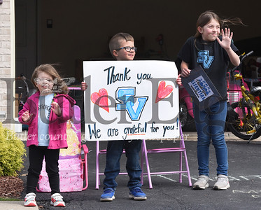 Harold Aughton/Butler Eagle: From left, siblings, Lilah, 4, a Seneca Valley pre-schooler, Easton, 7, first grader at Rowan Elementary, and Alaina Ptak, 10, a 5th grader at Haines Elementary, show their support to their teachers Monday morning, April 27, 2020.