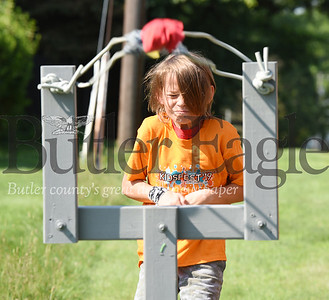 Harold Aughton/Butler Eagle: Elijah Furman, 9, of Butler launches a bean bag during Orchard Hill's Kidfest Saturday, July 27, 2019.