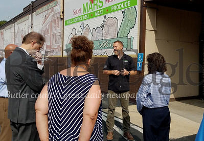 """Mars Walk 1: Photo by Samantha Beal. """"Brian Cooper (second from right) of Salvaged PGH explained to borough visitors yesterday he found a space in Mars Borough that fits his business' needs and his customer demographic."""""""