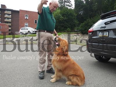 John Osheka with his comfort dog, Sunny. Photo taken by Eric Jankiewicz.